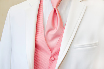 white tuxedo with pink tie