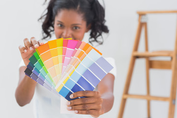 Excited woman showing colour charts
