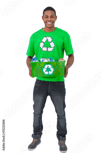 Smiling man holding box of recyclables