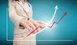 Businesswoman touching futuristic red and white graph with arrow