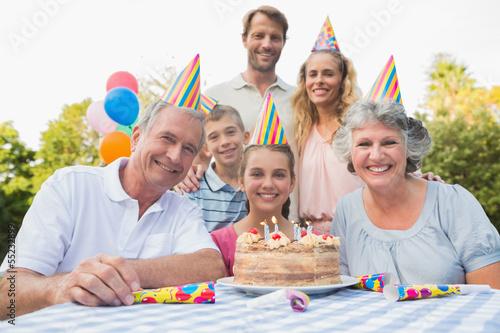 Cheeful family smiling at camera at birthday party