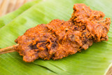 Fried chicken on banana leaf Thailand style