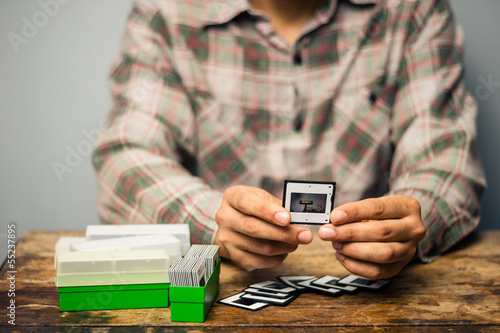 Man looking at his old slides
