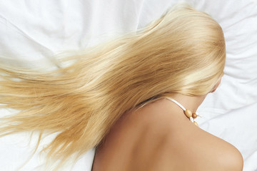 lond blond hair. beautiful blond woman sleeping in the bed