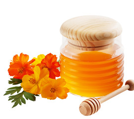 Jar of honey and wooden wand isolated on white background