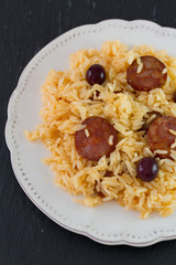 sausages with rice on the plate