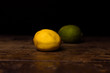 Lemon and lime on wooden surface