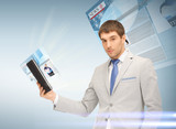 businessman with tablet pc reading news