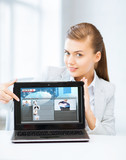 woman showing laptop pc with news