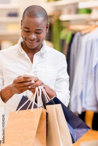 Shopping man texting