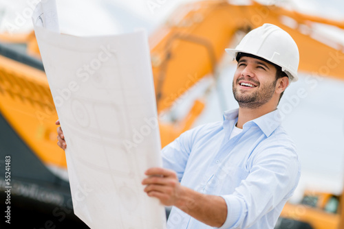 Architect looking at blueprints