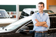 man standing near a car