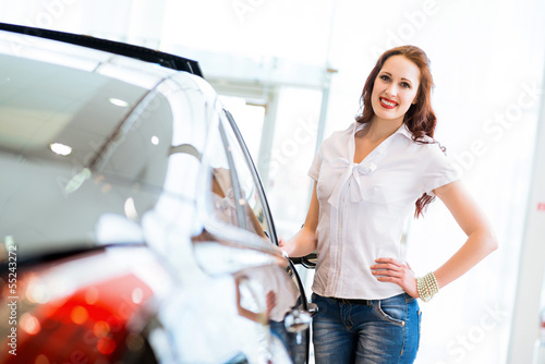 young woman standing near a car