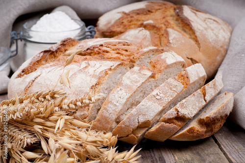 Fresh bread on wooden ground