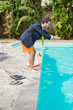Funny Young Businessman with SwimmingTrunks Diving  into the Poo