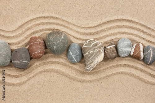 Plexiglas Zen Stenen Striped stones on the sand