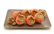 persimmons in brown plate