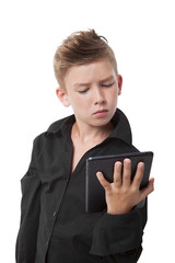 Charming boy with tablet.