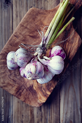 Garlic  bulbs on a wooden kitchen board