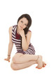 Woman striped pruple dress sit side hand chin