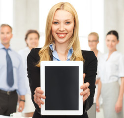 smiling woman with tablet pc in office