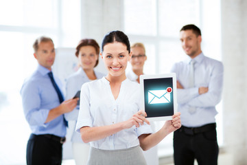 businesswoman holding tablet pc with email sign