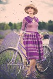 Woman in purple dress in lavender field