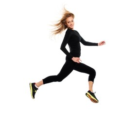 Beautiful sporty girl jumping isolated on white background