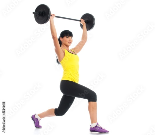 Beautiful fitness girl liftings weights