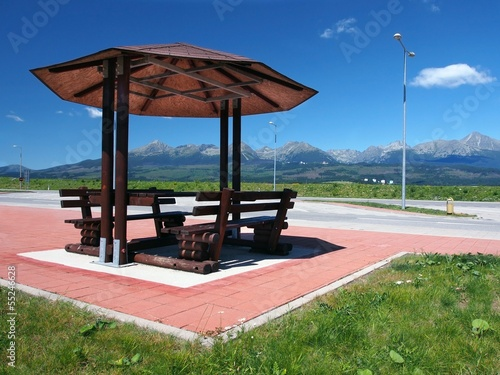 Shelter with benches and High Tatras