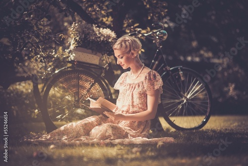 Blond beautiful retro woman reading book