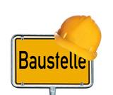 Schild mit Bauhelm - Baustelle