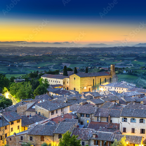 San Gimignano night aerial view, church and town. Tuscany, Italy