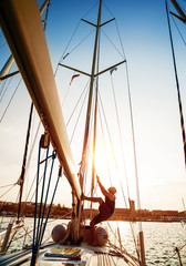 Young sailor on sailboat
