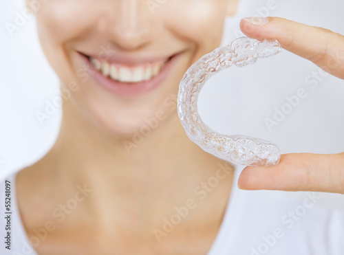 smiling girl with tooth tray