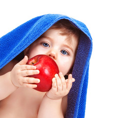 Pretty toddler eating apple