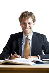 Smiling businessman at work