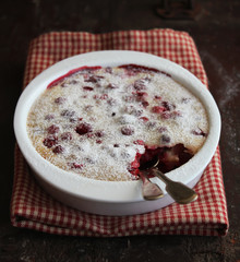 Homemade assorted berries clafoutis with icing sugar