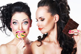 Glam. Funny Women holding Sweets. Positive Emotions. Vitality