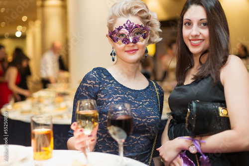 Two young woman on costume party