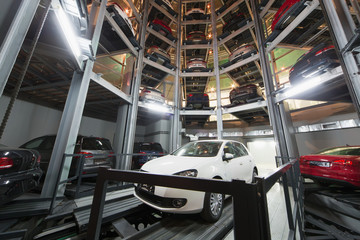The white car on parking lot with automated car parking system