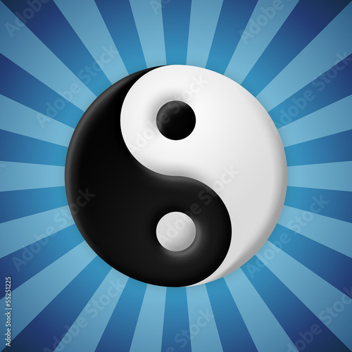 Yin yang symbol on blue rays background