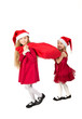 girls in dress in bell Santa Claus dragging bag of gifts