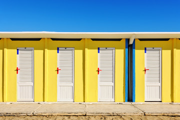 Bright yellow beach huts in Rimini