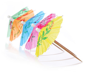 Multicolored Cocktail Umbrellas. Simmer symbol, isolated