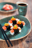 Shirataki sushi with salmon and caviar, selective focus