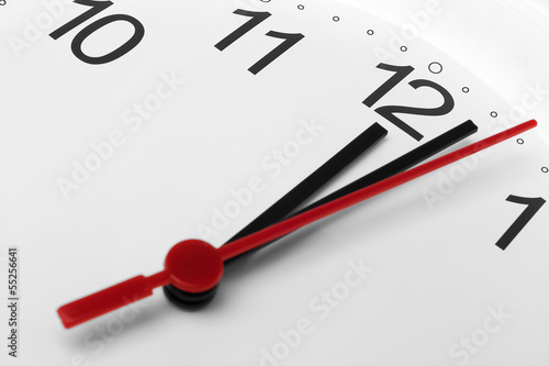 Clock face showing lunch time on white background