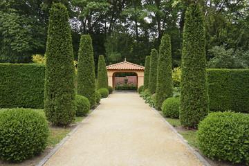 Path in Italian formal garden leading to a pavillion