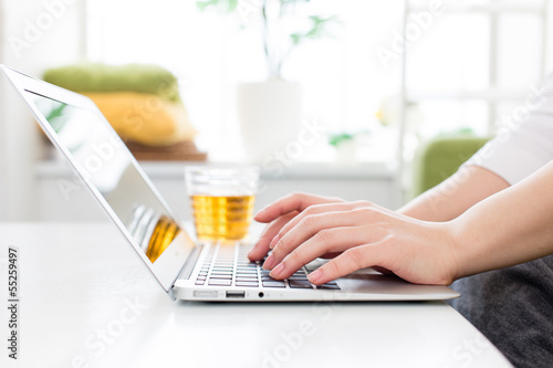 a young woman using laptop computer