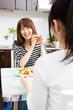 beautiful asian women eating in the kitchen